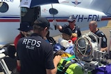 RFDS crews transport a patient from Kowanyama