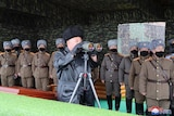 North Korean leader Kim Jong Un, centre, inspects the military drill of units of the Korean People's Army.