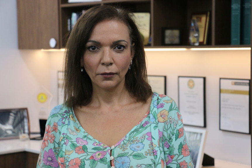 A head and shoulder shot of Anne Aly sitting in her office.