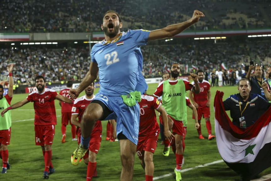 Syrian players celebrate after progressing towards the World Cup finals.