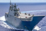 An Australian warship in the middle of the ocean with another warship in the distance background.