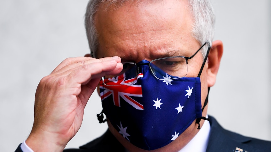 The PM with a face mask