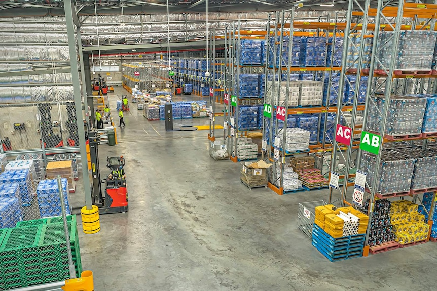 Interior of Woolworths Regional Distribution Center in Townsville, a large warehouse with shelves full of pallets
