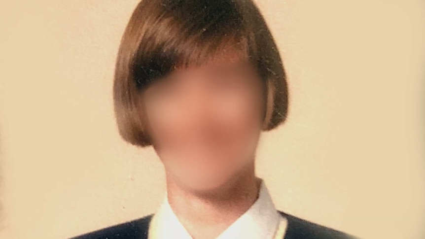 Blurred profile photo of a young woman with a bob hair.