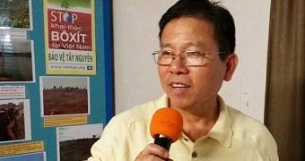 Australian activist Chau Van Kham holds an orange microphone.