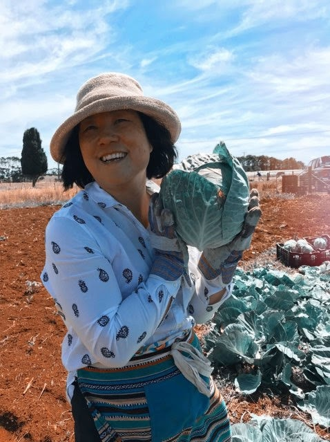 Sue Glynn proudly holds one of her home grown cabbaged aloft.