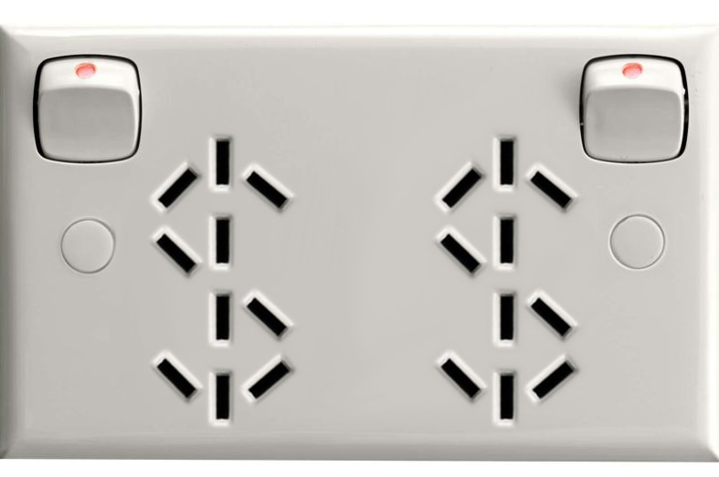 A power point with contact openings arranged in the shape of dollar signs.