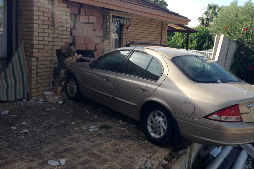 A wall has been hit and internal bricks show after a car crashed into its side in Parmelia