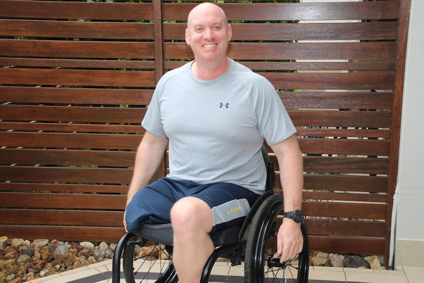 Byron Smith in his wheelchair in a courtyard