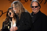 Jenice Heo, Gary Burden and Neil Young receive the Best Boxed or Special Limited Edition Package