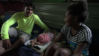 Refugee with his wife and baby