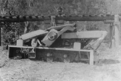 a black and white picture of a locomotive smashed up after an accident