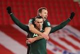 Gareth Bale and Harry Kane celebrate scoring a goal.