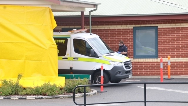 North West Regional Hospital ambulance and paramedic in mask, Burnie, Tasmania, April 2020