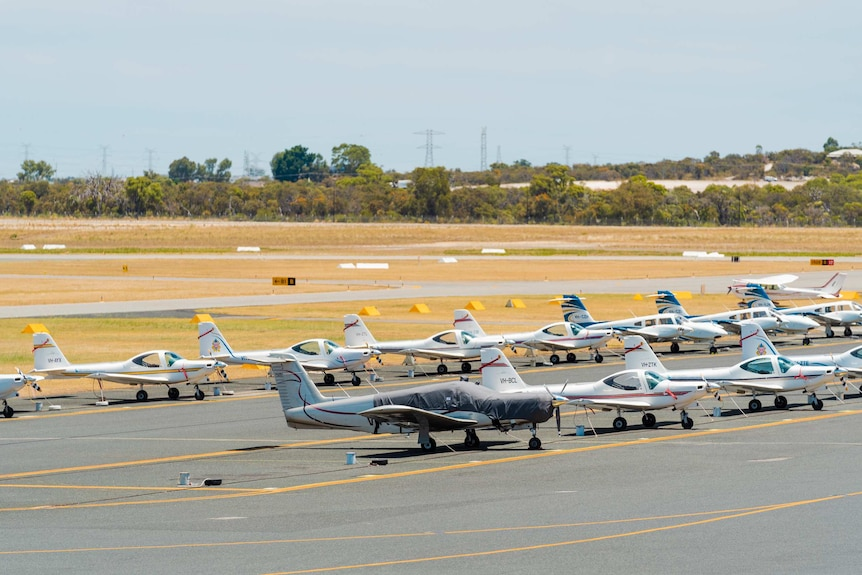 A wide shot of China Southern planes parked on the tarmac at Jandakot Airport in Perth.