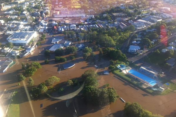 A CareFlight helicopter provides an aerial view of Gympie after Cyclone Marcia