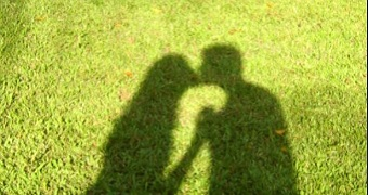 A shadow of a couple kissing.