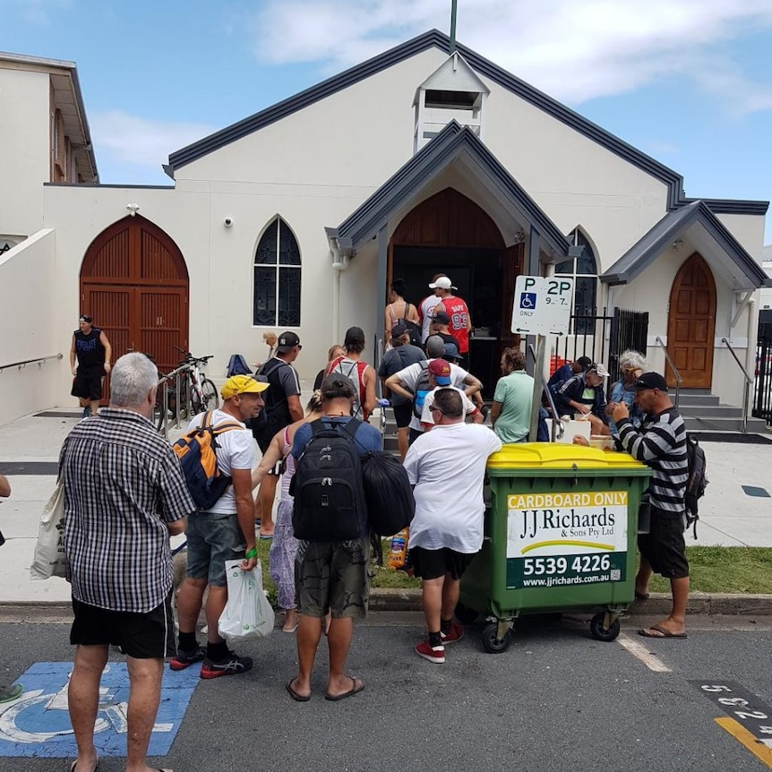 People line-up at the soup kitchen at St John's Crisis Centre in Surfers Paradise