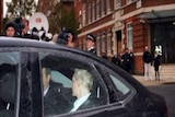 Julian Assange arrived at the London court by car but left in a prison van.