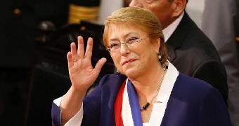 Former Chilean president Michelle Bachelet waves as she gives her last State of the Nation speech.