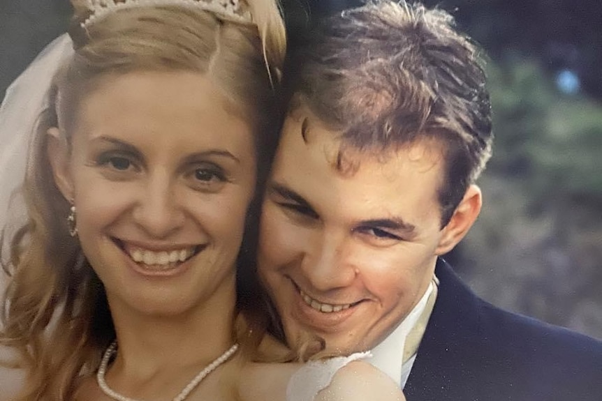 An old wedding photo of Kelli and Matt smiling.