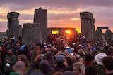 Revellers watch sunrise at Stonehenge
