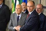 Italian prime minister-designate Enrico Letta (R) announces new government