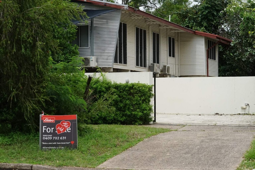 A sold sign sits outside a tropical house in Darwin's suburbs.