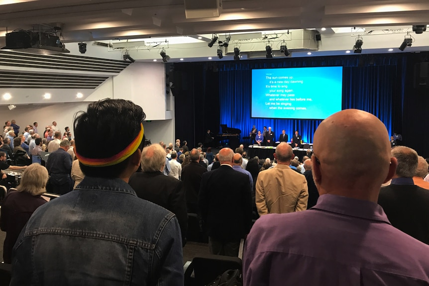 LGBT Anglicans watch Sydney Synod proceedings from the public gallery at Wesley Theatre in Pitt Street.
