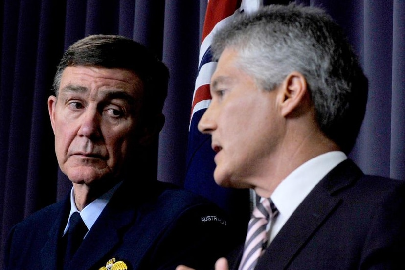 Air Chief Marshal Angus Houston listens to Defence Minister Stephen Smith
