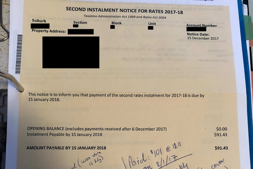 A bland, yellow document with even fonts and a bold payment request.