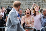 Lisa Millar shouts a question at Prince Harry.