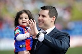 Former Newcastle Knights player James McManus with his daughter Evelyn at Hunter Stadium in Newcastle.
