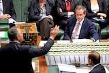 Bill Shorten listens to Joe Hockey as Tony Abbott looks on in Question Time.