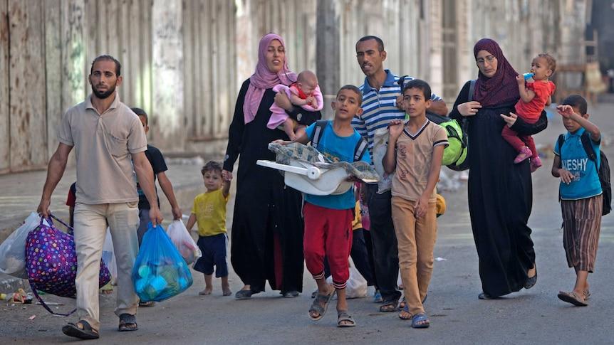 Palestinian families are leaving their homes in Gaza City's Shejaiya neighbourhood in fear of Israeli attacks.